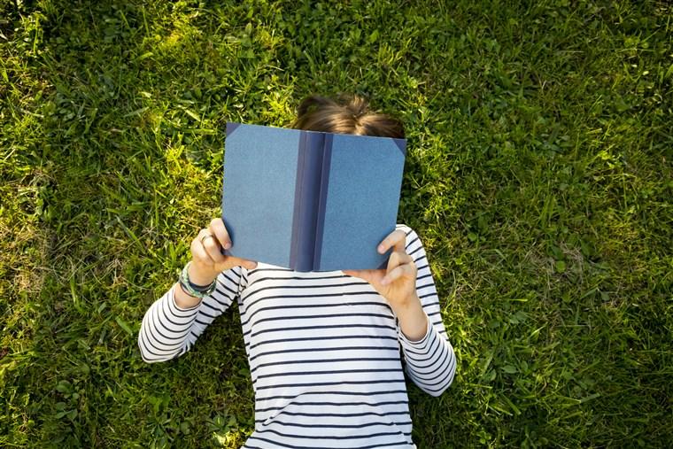 181212-woman-reading-book-grass-stock-cs-1235p_ee32881d5bf47c628985390c83d6d8e8.fit-760w